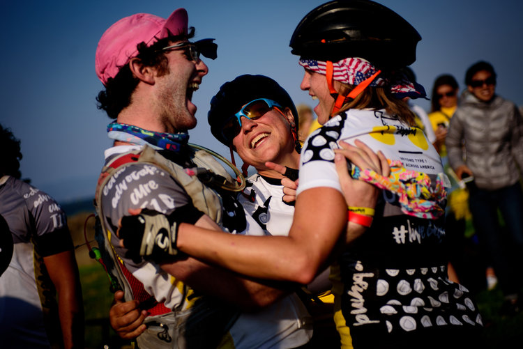 Crying AND Laughing at the finish line !!! Love this family. Photo credit: Lindsey Freitas