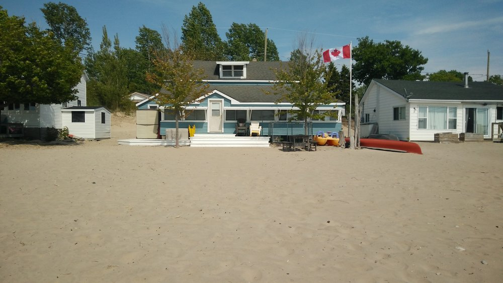 So much sand here they put the cottages right on the beach.
