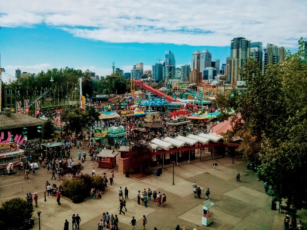 The bustling midway of the Calgary stampede. Ride 'em, cowboy!