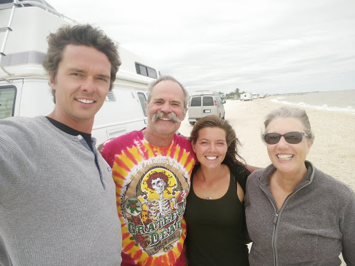 "A blustery day with some new old friends on Magnolia Beach.  Chris and Jules' ""Falcon"" was a great source of envy and inspired us to improve our own little home on wheels."