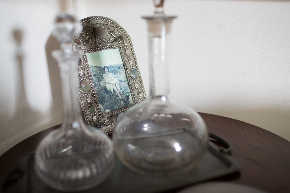 I remember these two decanters and this photograph have been on the top of this cabinet for as long as I can remember. Even in their old house it looked the same. Perhaps its how it has always been arranged?
