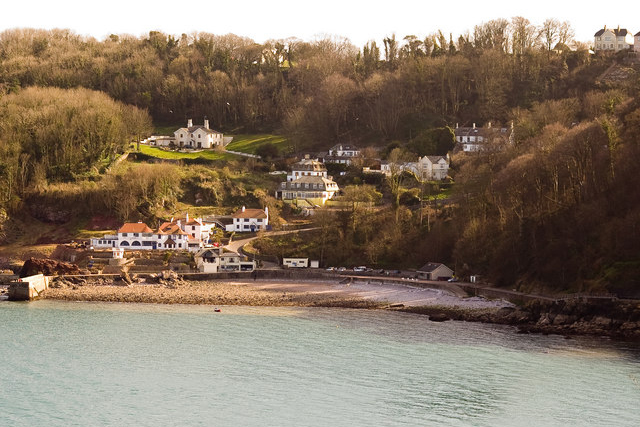 Babbacombe Beach. I spent loads of time there as a child. I seem to remember we went on a Sunday afternoon after lunch. The right hand side of this image near the cliffs is all closed now as the cliff has fallen into he see taking the house that was built on it down with it.