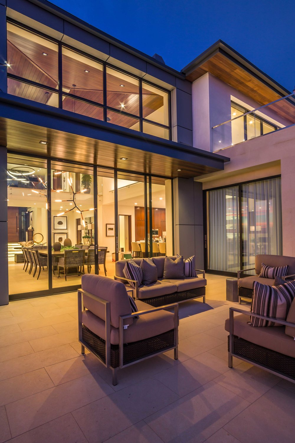 Exterior Twilight photograph of Modern Luxury home In Dover Shores Newport Beach