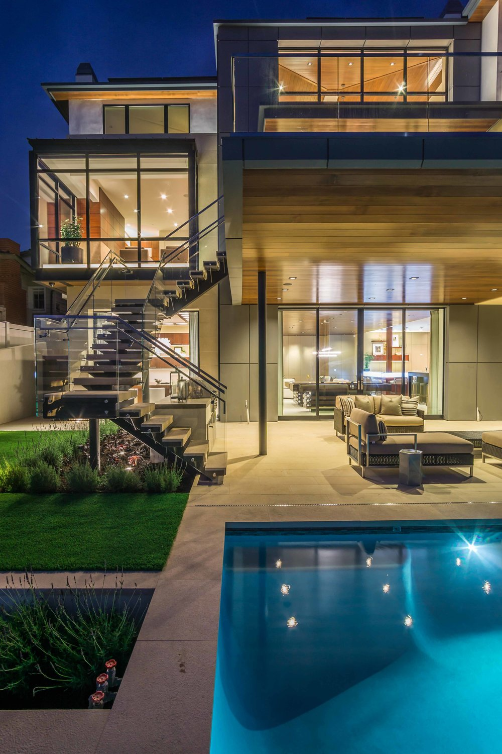 Exterior twilight photograph  swimming pool and Patio of luxury home on Kings Road in Newport Beach