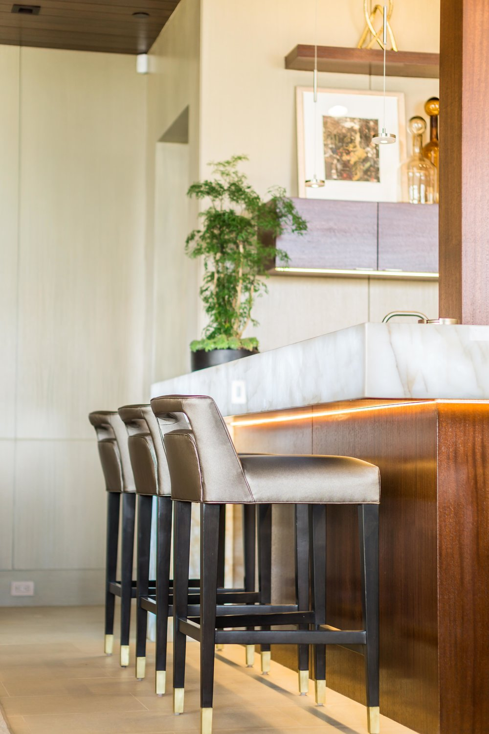 Professional interior photograph a Modern and sleek Led Illuminated bar and barstools