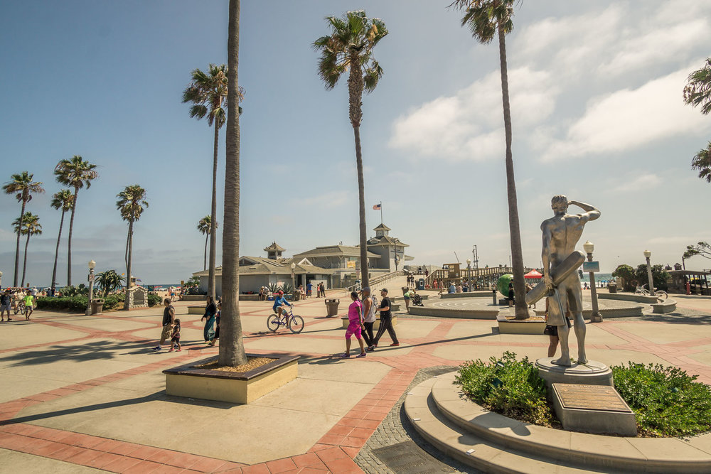 Newport Beach pier Plaza on a sunny afternoon ben lifeguard Monument