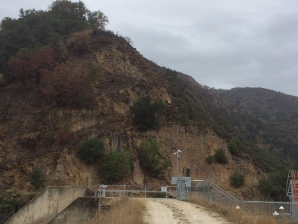 The aftermath of the Soberanes Fire shows scorched hills above the Los Padres Dam
