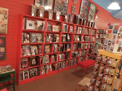 Painted slat wall fits the budget and suits display needs for random size and shape merchandising.