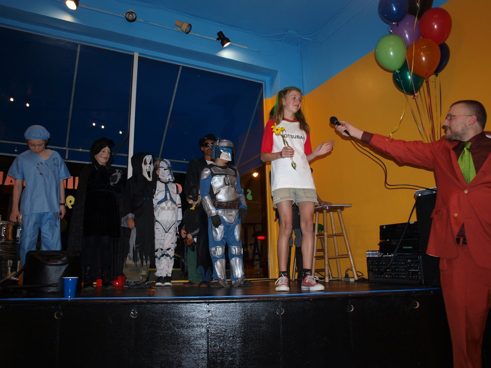 Here is my husband hosting a costume contest on said stage!