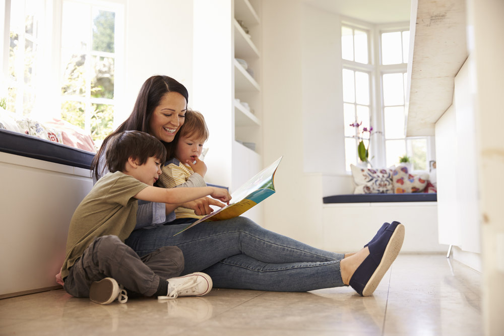 bigstock-Mother-And-Sons-Reading-Story--141781586.jpg