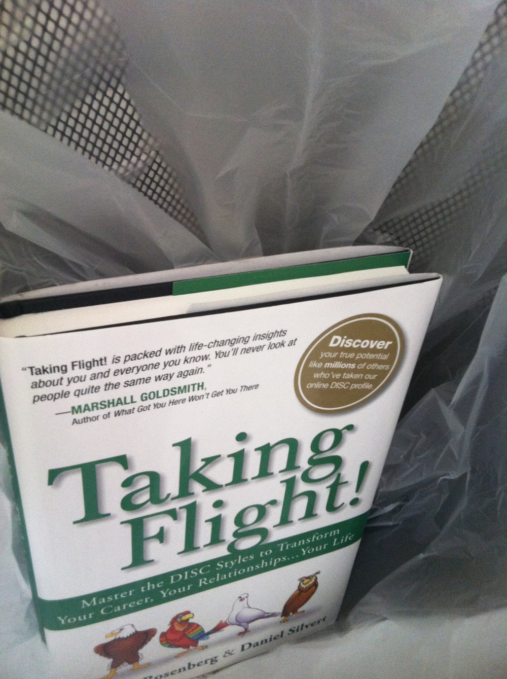 """I've never thrown away a book before, but here goes. My brother gave meTaking Flight!as a jokeafter he got it from a work retreat.The book invites you to """"master yourDISC style to transform your career, your relationships…your life.""""I've always liked personality tests, perhaps because they offer a sense of certainty about myself that I do not always feel.So I decided to see what the book was all about on the train this morning, and started reading: It began with a subtle crackling sound–hardly noticeable at first. Hm… An aftershock of anxiety rippled deep within the forest, known simply as 'Home.' Uh-oh… High above it all flew Dorian, a majestic eagle with a proud, sharp gaze and impressive seven-foot wingspan. I searched the book to see what DISC even means, flipping through page after page of a story about animated birds working together. It turns out 'D' in DISC stands for Dorian, the eagle (and for """"dominant,"""" """"direct,"""" """"decisive,"""" and """"driven,""""–all part of Dorian's leadership approach). The other letters stand for other bird characters in the book.I flipped to the back and read about the authors. One has an MBA and is an entrepreneur. The other is an """"executive coach."""" I imagined them in a grim conference room leading a group of office workers in an exercise where they discuss who is Dorian, who is Ivy (another bird), who is Samuel, etc. And then I asked myself, what do the authors of Taking Flight know about me that I don't know about me? Why do they get paid for this? I wasn't going to do it. I wasn't going to fill my head with DISC. I've read much better self-help books recently, such as The Happiness Trap and The Road Less Traveled. In fact they're too good to be referred to as self-help books, especially in the same breath as Taking Flight! I didn't want other people to do it either. So I threw the book in a garbage can."""