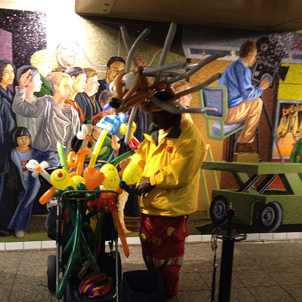 I quickly took this photo in the Times Square subway stop about a week ago. I was mainly trying to capture the delightfully absurd picture of a man wearing balloon animals, but serendipitously, he was standing in front of  this Beaux-Arts mural (according to my Dad) in the station. Not only is it just a wonderfully chaotic splash of colors, but it is also striking that the balloon animal vendor is facing an opposite direction from all of the mural characters behind him.