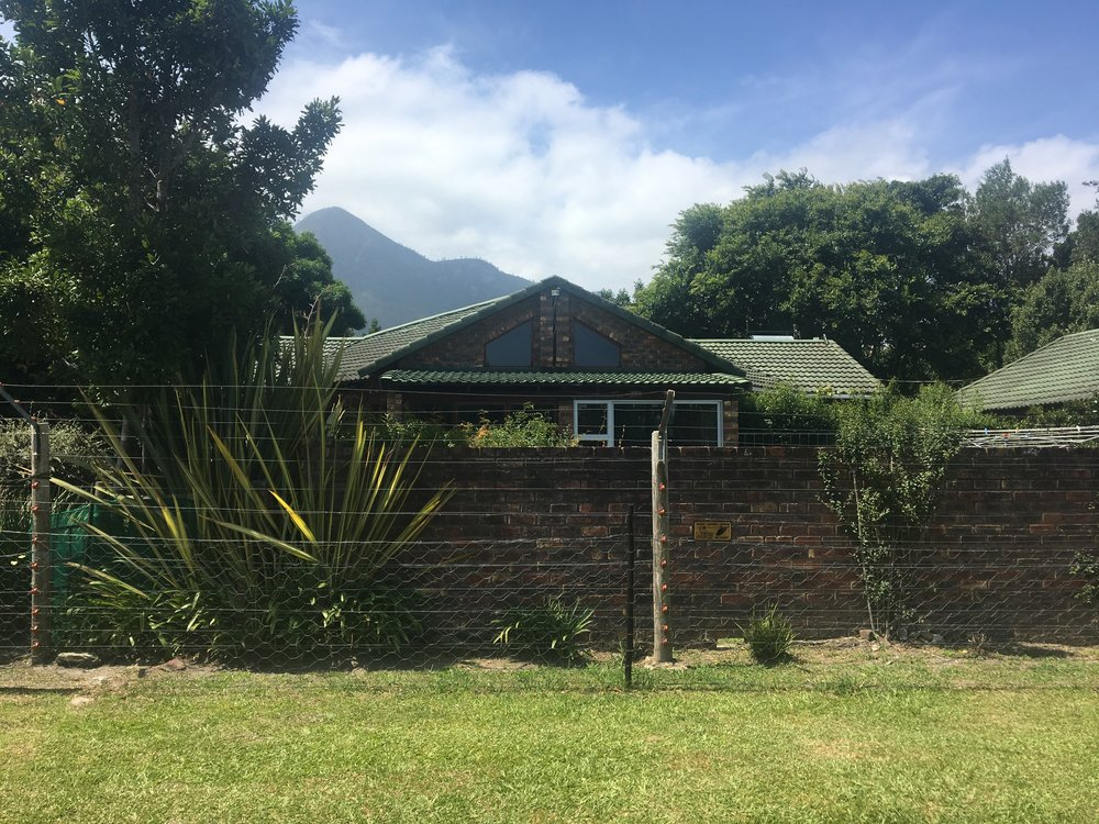 Our rental in Storms River in the Eastern Cape: hard to see the lovely home behind the wall and wire fence