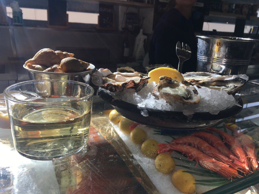 Oysters, whelk, and wine at Biarritz's indoor covered market