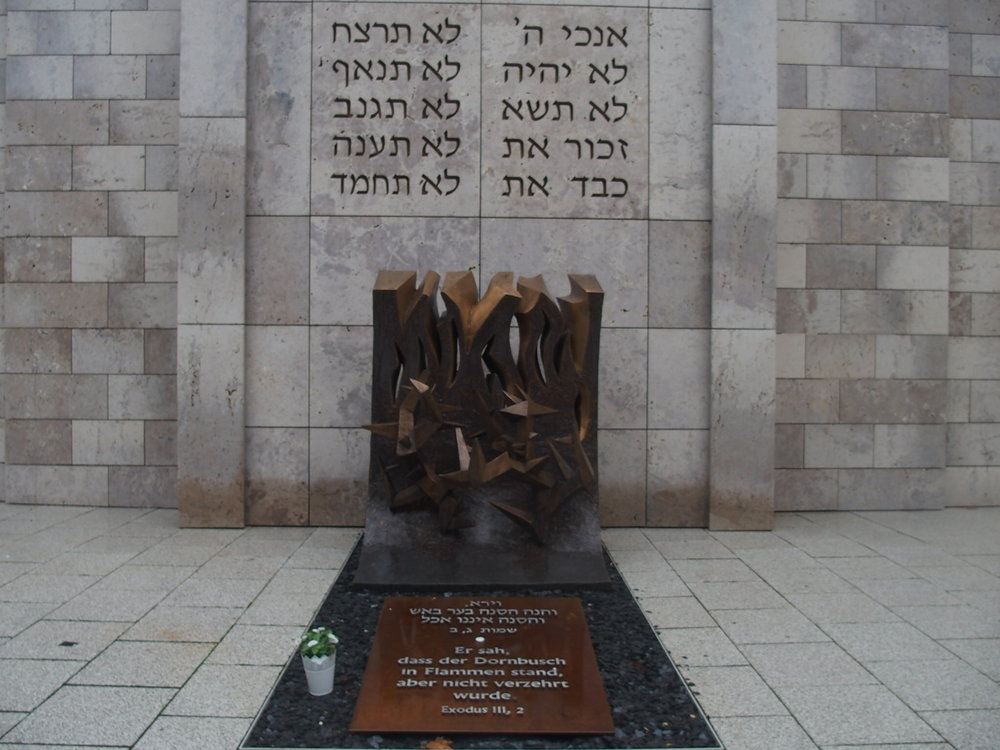 """the  Stuttgart Jewish Community Center  with a quote from Exodus describing Moses's encounter with the angel of God at the burning bush where he is told to lead the Israelites out of Egypt: """"He saw that the bush was on fire but not consumed."""""""