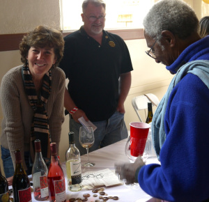 Karen Steinwachs, winemaker for Buttonwood Farm Winery, with Al Harry tasting, right