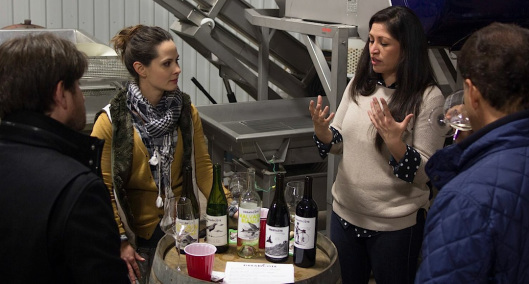 Brit Zotovich, left, and Anna Clifford discuss Dreamcôte Wine Co. with two writers at a private tasting in December.