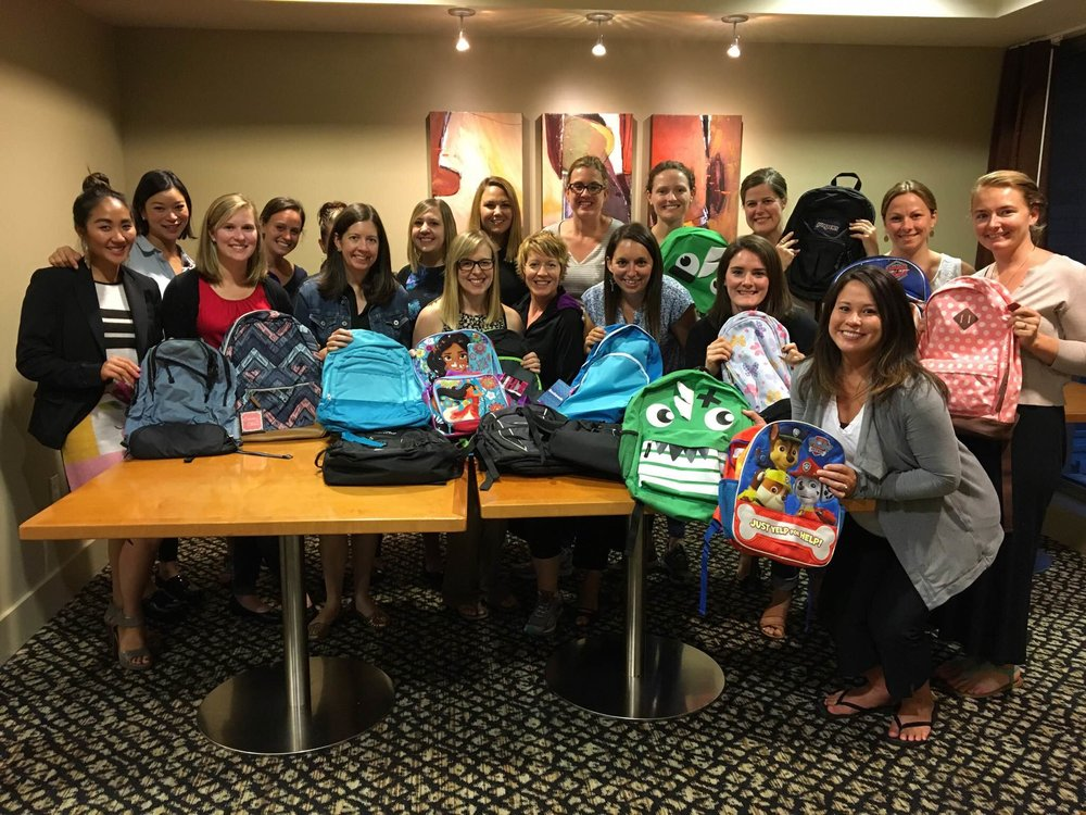 WPIG members collected 36 backpacks and 2 bags of schools supplies for Mary's Place Back-to-School supply drive. (2016)