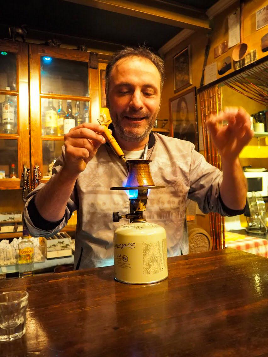 Hot tsipouro from the friendliest taverna in Ioannina