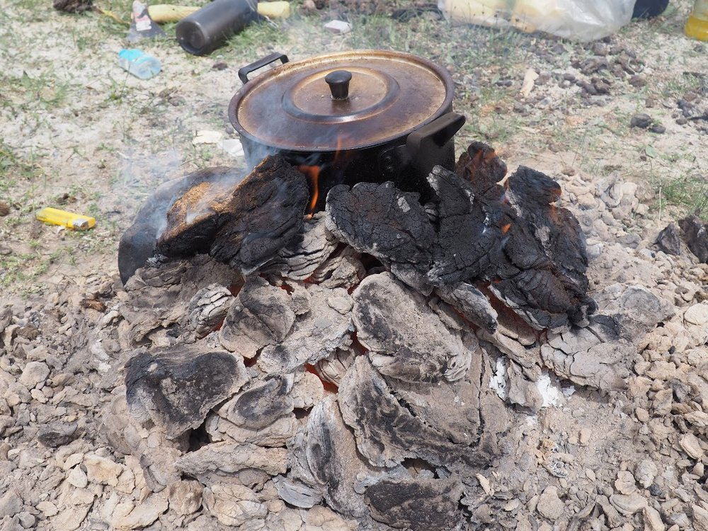 Dried meat and rice over dung fire