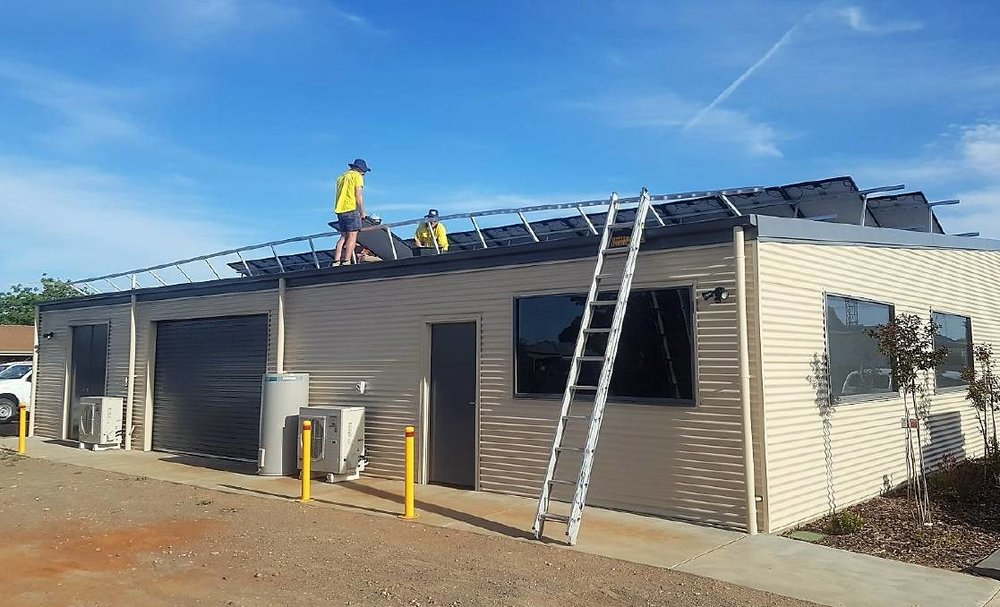 Solar panels being installed on the BCG office; the remainder of the project - including batteries and SwitchDin energy management system - will be completed next year.