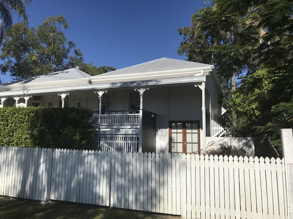 Addition of a home office, lounge room, bedroom, new kitchen, bathroom and deck to an old Queenslander.