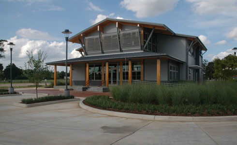 - Holly and Smith Architects approached Dufreche-Perkins & Associates to provide Landscape Architecture for this new bank building. A specific effort was made to set this unique building apart from its local peers by providing a slightly unconventional landscape setting. Liberal use of stone and ornamental grasses was made to provide a palate of texture not often seen locally. The building's location at a traffic intersection provides a high-visibility setting to display the dramatic combination of architecture and vegetation.