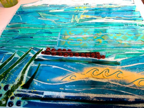 Side panel with seaweed and waves in glass ready to fuse in kiln.