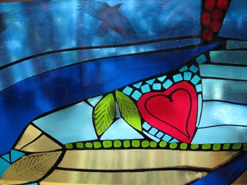 Birds and hearts in fused glass.