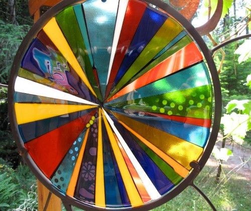 Fused glass pinwheel in steel garden stand