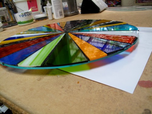 Fused glass pinwheel before firing in the kiln.