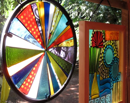 Fused glass and steel pinwheel, fused glass and wood framed window.