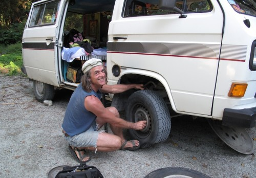 Cute guy fixing the flat tire.