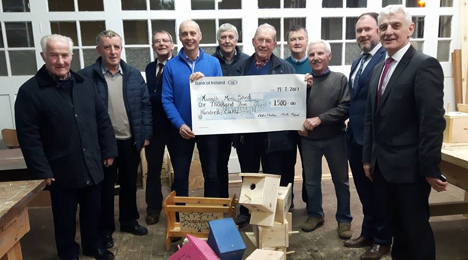 - Martin Meade, Chairperson of Mountrath Community Forum, presenting the Men's Shed Mountrath with a cheque which was awarded to them by Pride of Place sponsored by Bank of Ireland.