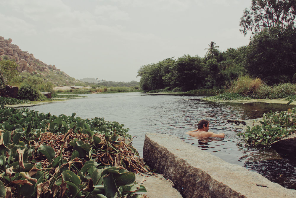Taking a dip in the Tungabhadra River in Hampi.