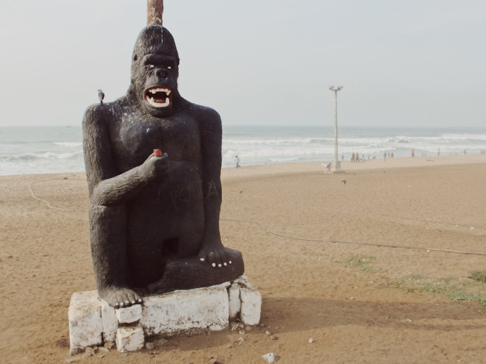 The gorilla statue looking particularly natural on the beach.