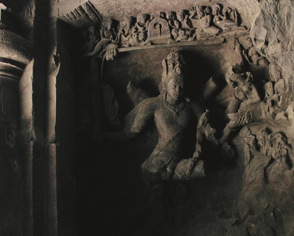 A sculpture from the Elephanta Caves on Elephanta Island which is located off the coast of Mumbai. The remaining rock-cut sculptures are predominantly dedicated to the Hindu God Shiva, but they also show an amalgamation of Buddhist and Hindu ideas and iconography.