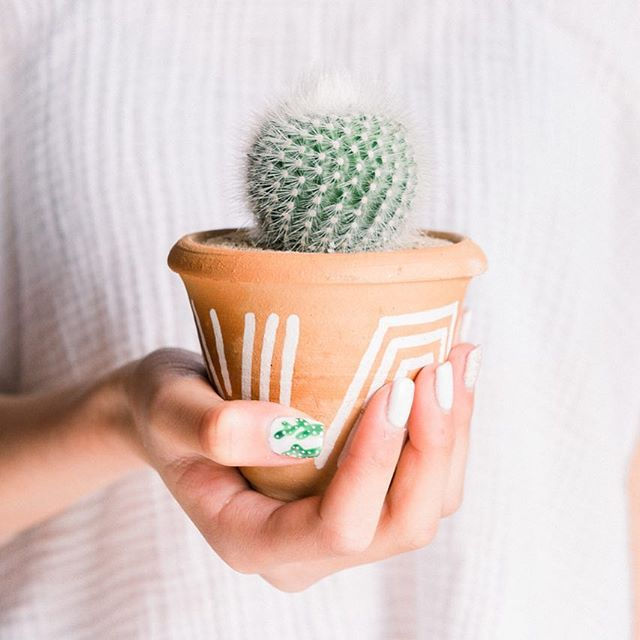 Just keep in' it green 🌿🌿🌿 Did you know when you select a container + plant @landmarkplantco and they will pot it for you?  We of course had to snap a pic of Eva's new plant with her matching mani by @nails_by_dee_lam  #pottedplants #green #cactus🌵 #landmarkplantco #cactusnails