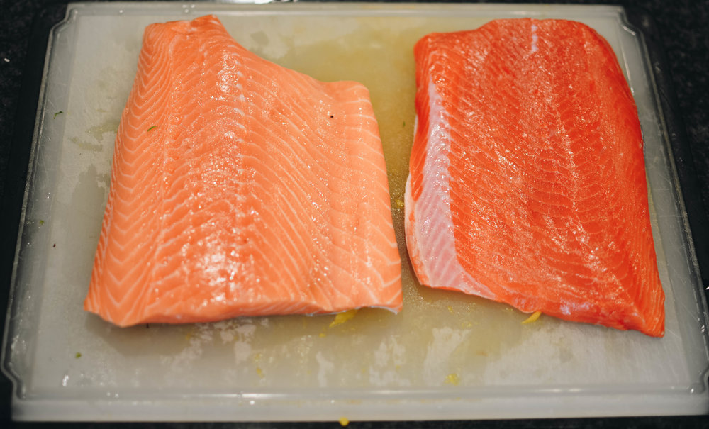 The salmon on the left is a farm raised king salmon. The one on the right is a wild caught sockeye salmon. Note the color difference. The sockeye will be more flavorful and the king will be more mild.