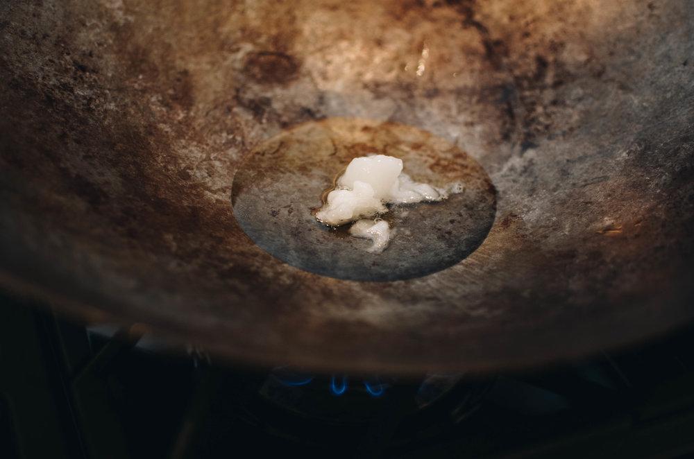 cocnut oil in wok
