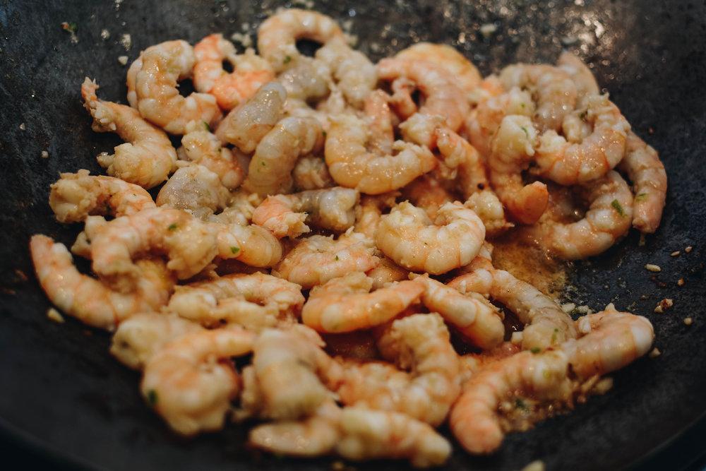 cooking shrimp in wok