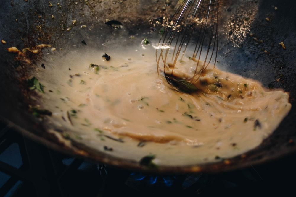 basil sauce in wok