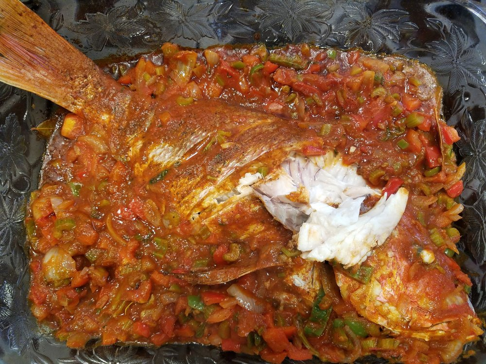cooked snapper with creole sauce