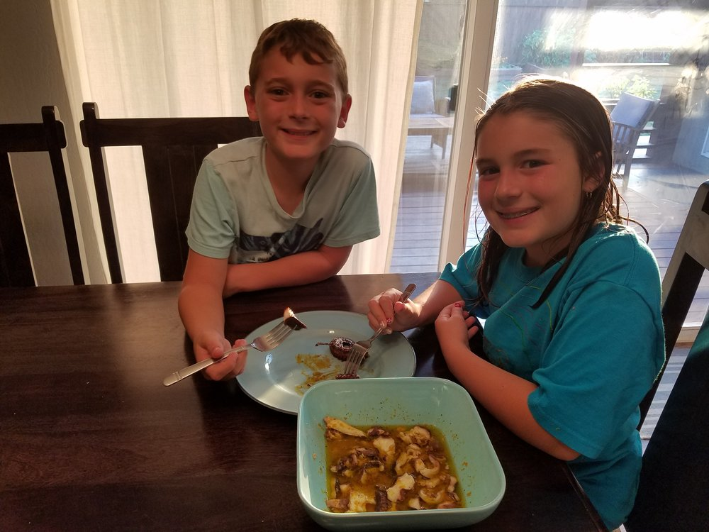 Our kiddos happily chomping on Octopus Carpaccio!