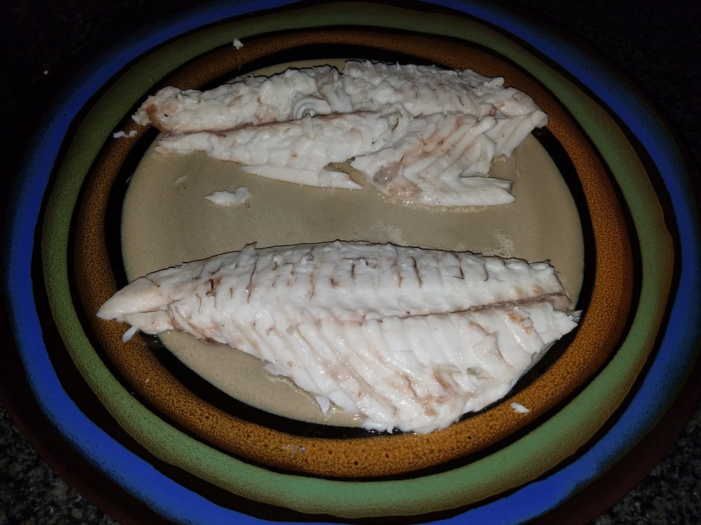 This is a rustic preparation and the top fillet is tough to get to the plate intact.  Don't worry about it.  This fish is delicious and interesting enough that your guests will forgive you.  Depending on your comfort level, this fish is often better served whole on a plate.  There is something special about just digging into a whole fish that is all yours.