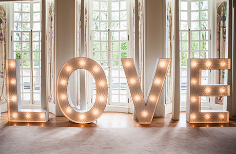 Giant Letter Lighting   Customizable large letters can be placed throughout your venue! Some fun ideas are: MAZEL TOV, CONGRATS, LOVE, MR & MRS, I DO, JUST HITCHED, or your last name.