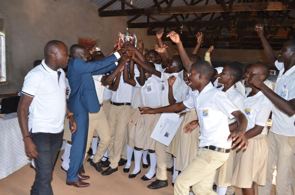 Lira Town College receive their Silver trophy from the RDC.JPG