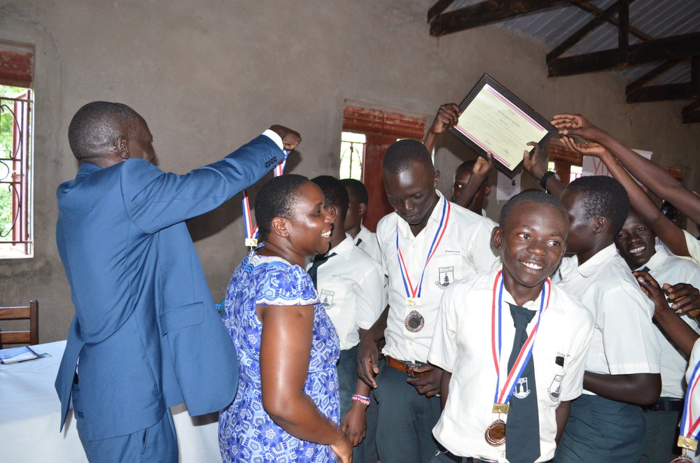 The D.E.O and RDC dress the second runners up with brnze medals.JPG