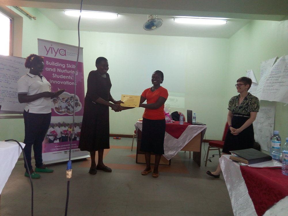 receiving certificate - lady teacher.jpg