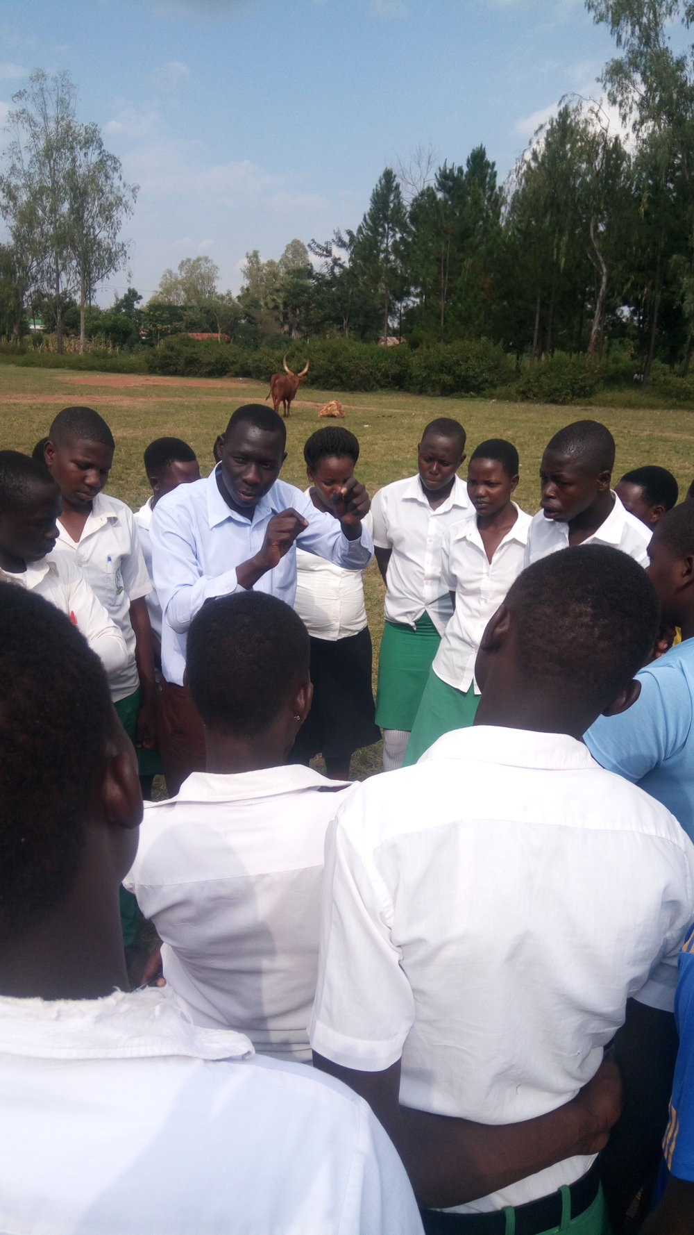 Musa and students checking transpiration experiments.jpg